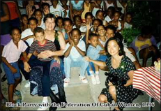 U.S. feminists with crowd of Cuban children