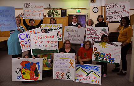 Group with hand-painted signs for childcare